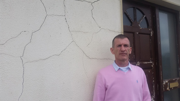 Mick standing by front door