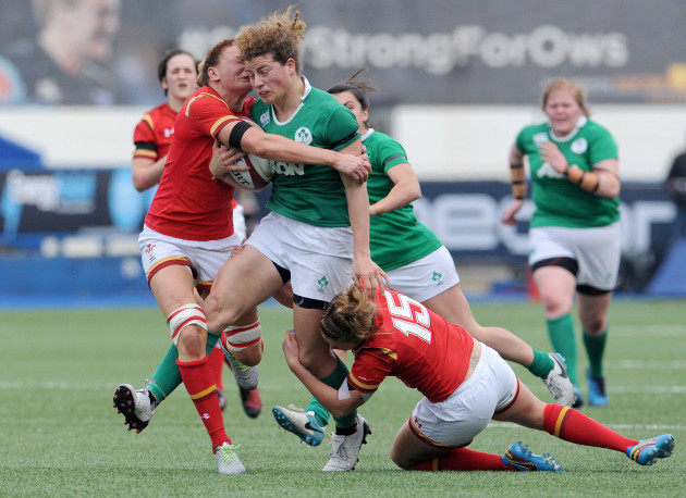 Jenny Murphy is tackled by Dyddgu Hywel and Rachel Taylor