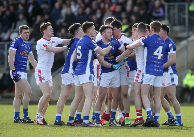 Tyrone and Cavan players tussle