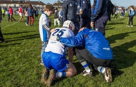 8 year old Sean Og O'Regan from Kilmacthomas comforts the injured Brian O'Halloran