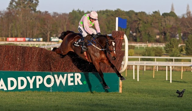 Min ridden by Ruby Walsh clears the first on the way to winning The Racing Post Novice Steeplechase