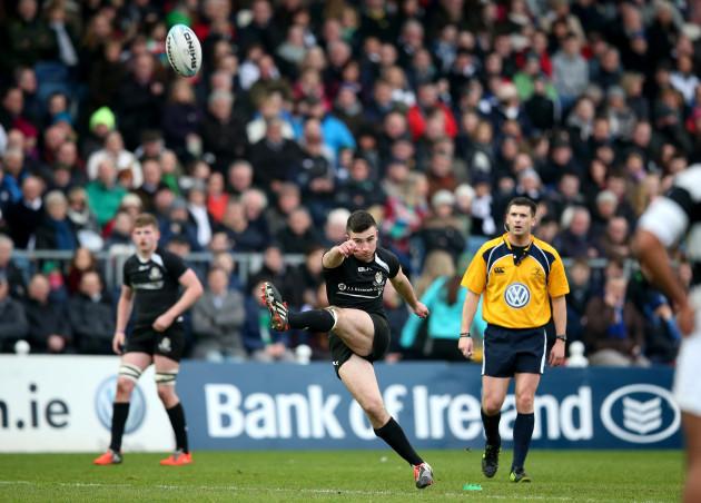 Tim Foley kicks