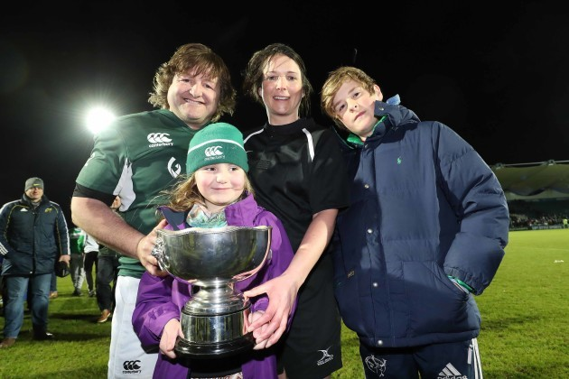 Ireland's Shane Byrne with the Stuart Mangan Cup and Olive Foley ,Siofra Foley (daughter of Rosie Foley) and Tony Foley at the end of the match