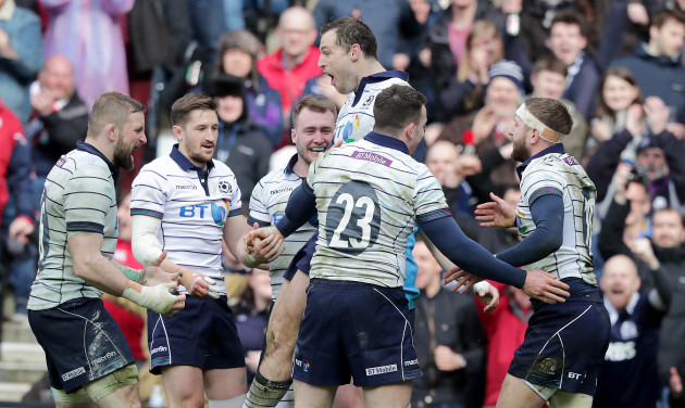 Tim Visser celebrates scoring a try with teammates