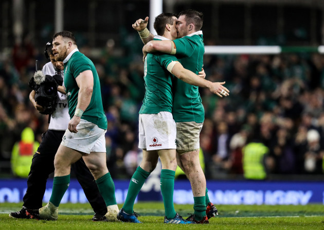 Johnny Sexton celebrates at the final whistle with Peter O'Mahony