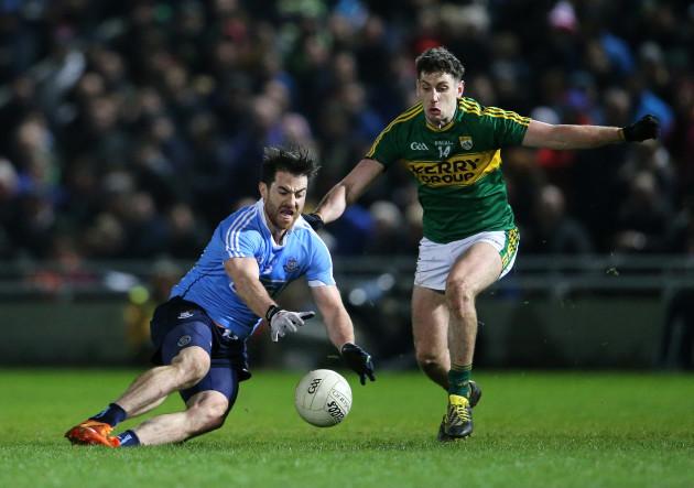 Paul Geaney tackles Michael Darragh Macauley