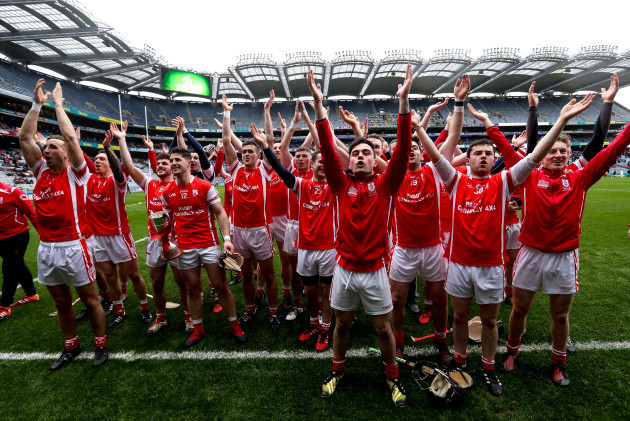 Cuala celebrate with the trophy to the fans