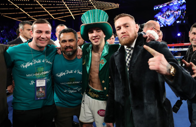 Michael Conlan celebrates with Matthew Macklin, Manny Robles and Conor McGregor