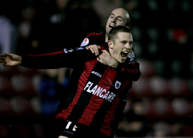 Sean Prunty is congratulated by teammate Alan Kirby