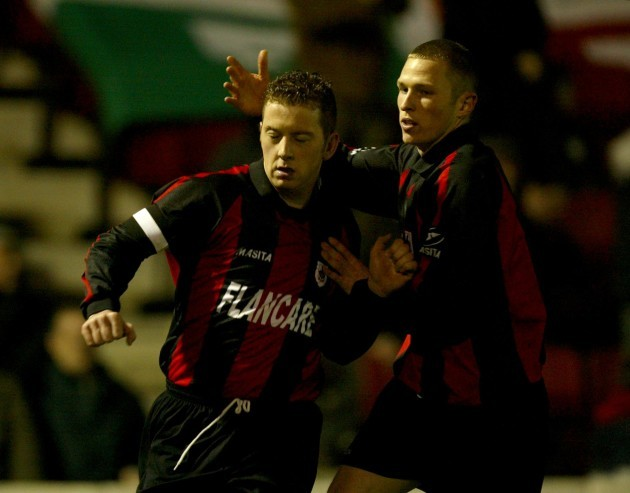Vinny Perth is congratulated by Sean Prunty 3/4/2004