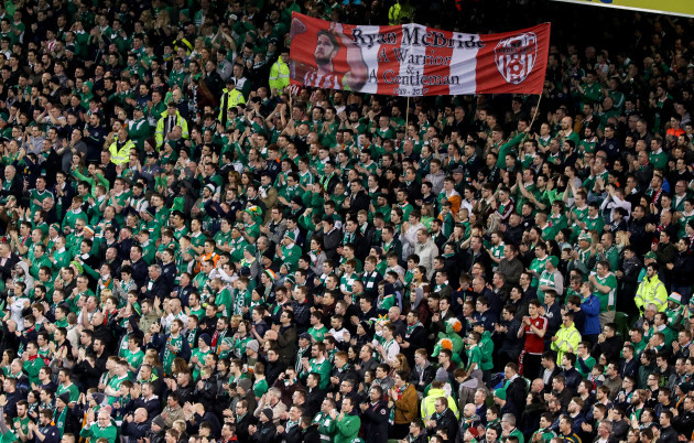 Ireland fans applaud during the 5th minute in respect for the late Ryan McBride