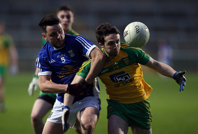 Donegal's Cian Mulligan with Shan O'Connor of Cavan