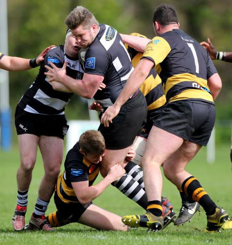 James McWilliams Gray is tackled by Jack Lyons and Gavin Ryan