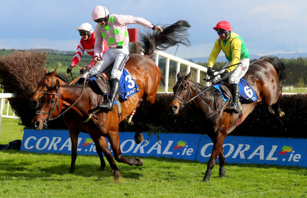Robbie Power on board Sizing John clears the last to win, beating Ruby Walsh on Djakadam and Nico de Joinville on Coneygree