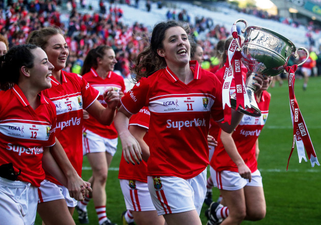 Ciara O'Sullivan with the trophy as the team celebrates