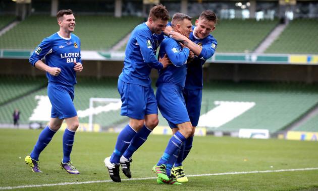 Stephen Murphy celebrates scoring with Joe O'Neill and Gavin McDermott