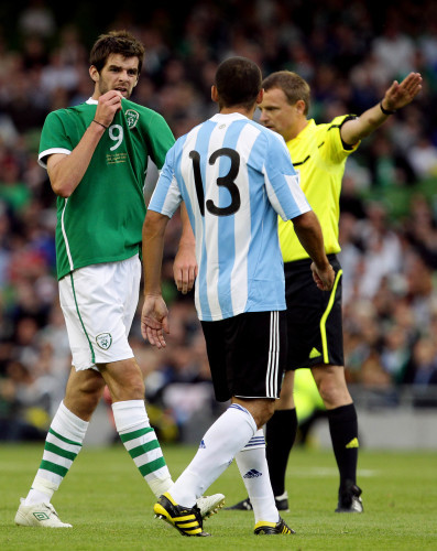 Cillian Sheridan gestures towards Walter Samuel