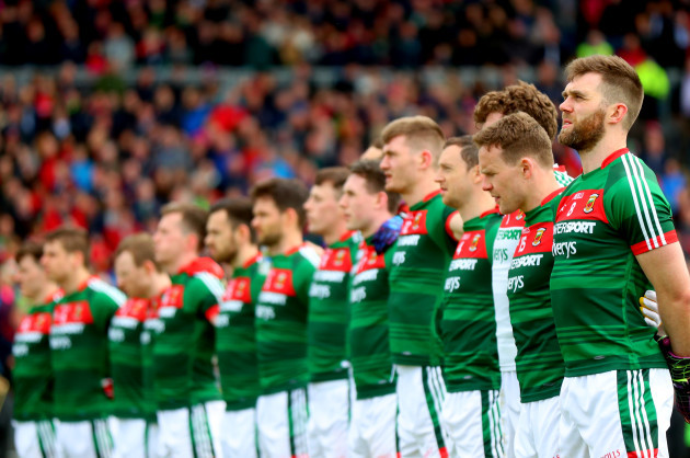 Seamus O'Shea stands with his team for the anthems