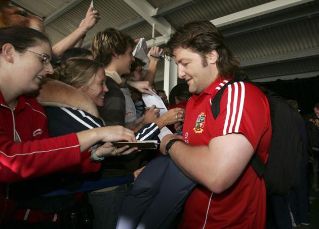 Shane Byrne signs autographs for fans after arriving