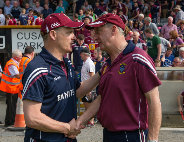 Michael Donoghue and Michael Ryan shake hands after the game