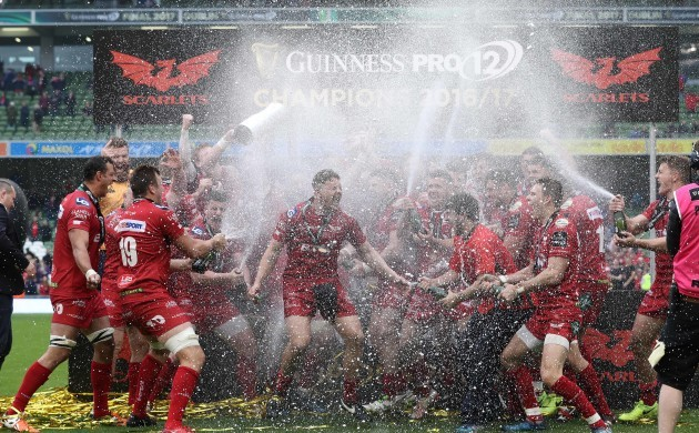 Scarlets celebrate with the trophy