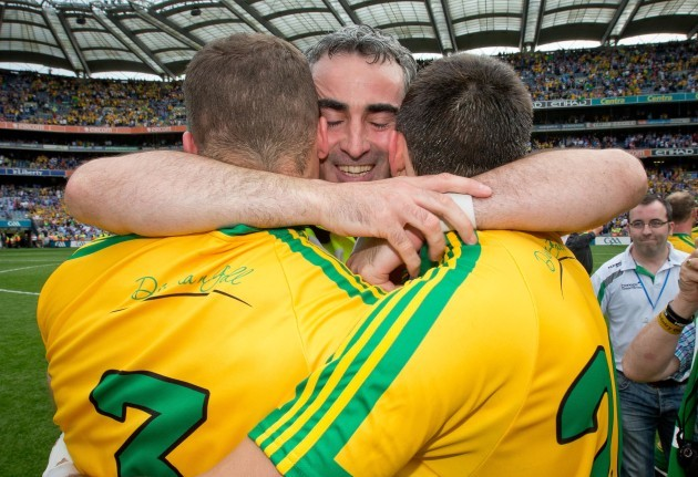 Jim McGuinness celebrates the final whistle with Neil McGee and Eamonn McGee