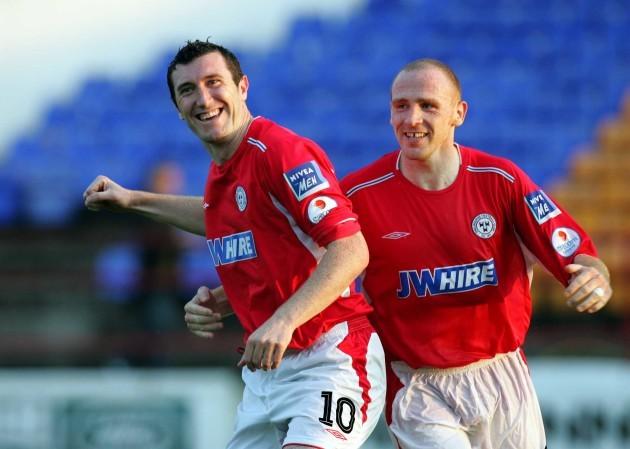 Jason Byrne celebrates scoring a goal with Glenn Crowe