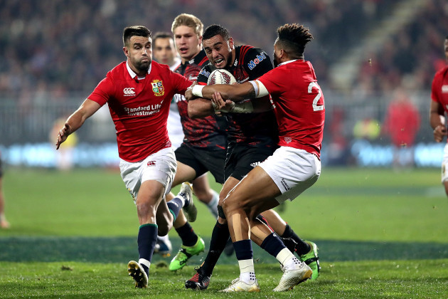 Bryn Hall is tackled by Conor Murray and Anthony Watson