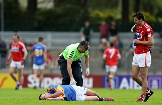 Michael Quinlivan down injured from falling awkwardly