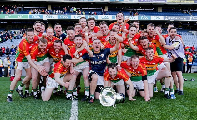 Carlow players celebrate after the game