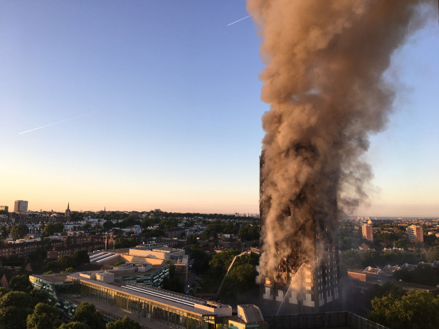 Grim search at London blaze site continues as anger mounts
