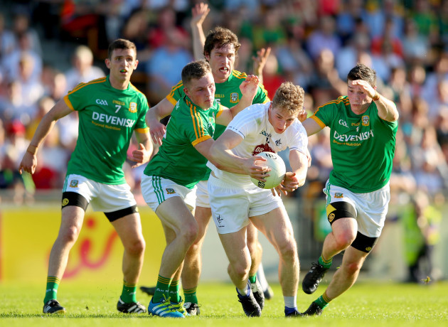 Shane McEntee, Conor McGill, Pauric Harnan and Donnacha Tobin tackle Daniel Flynn