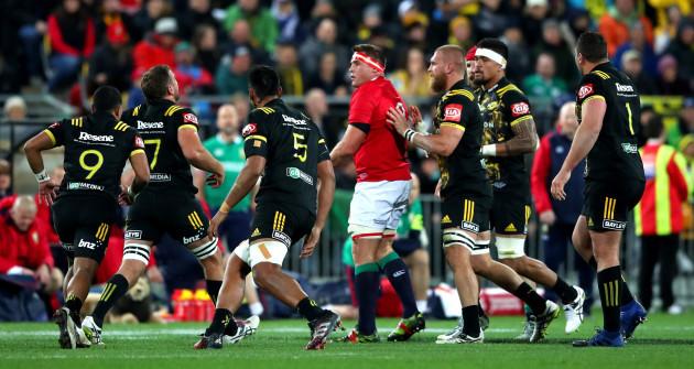 CJ Stander surrounded by Hurricanes players