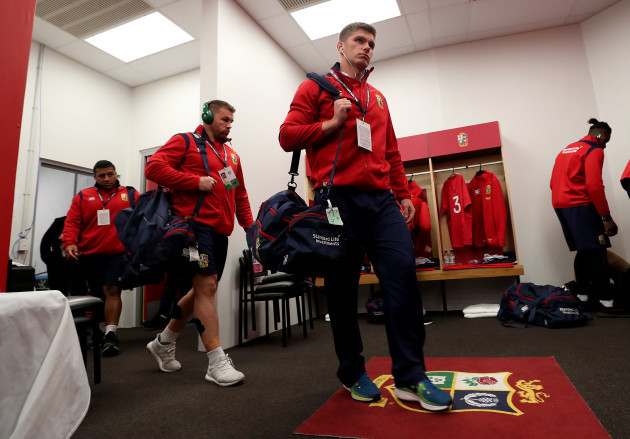 Owen Farrell enters the changing room