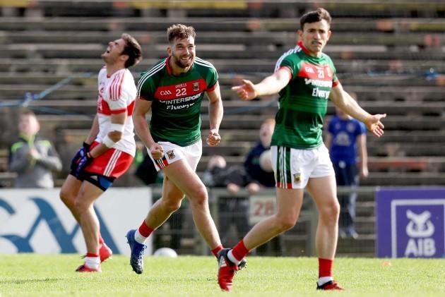 Aidan O'Shea celebrates scoring a point