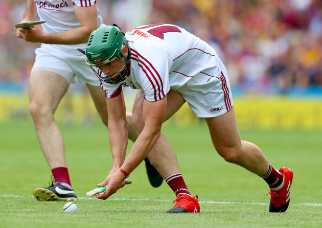 Niall Burke attempts to play with a broken hurl