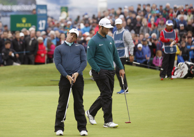 Rory McIlroy reacts after missing a putt on the 18th