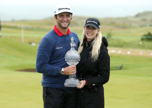 Jon Rahm celebrates his victory with partner Kelley Cahill