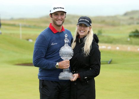 Jon Rahm celebrates his victory with partner Kelley Cahill