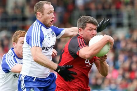 Down's Kevin McKernan and Vinny Corey of Monaghan