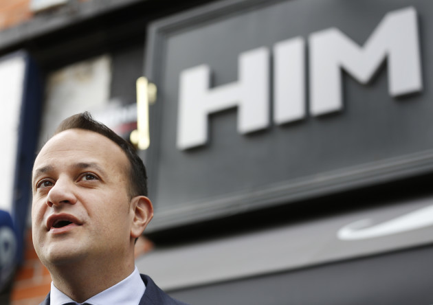 Pictured is Minister Leo Varadkar standing under a sign that says HIM