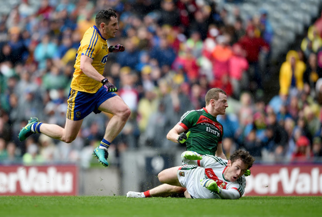 Ciarain Murtagh scores a goal despite the efforts of David Clarke and Colm Boyle