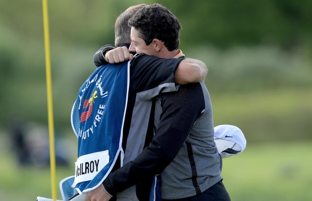 Rory McIlroy celebrates with caddie JP Fitzgerald after winning The Irish Open