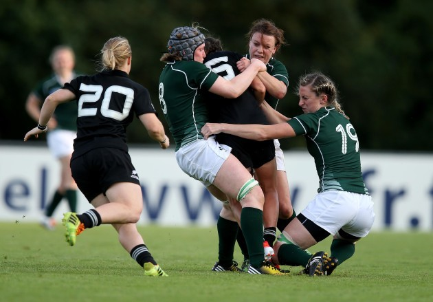 Siobhan Fleming, Heather O'Brien and Lynne Cantwell tackle Selica Winiata