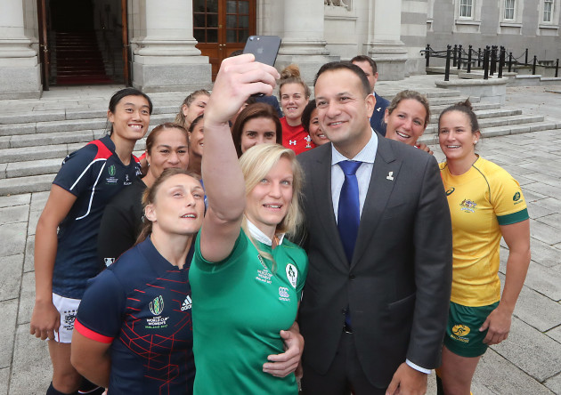 An Taoiseach Leo Varadkar takes for a selfie with Claire Malloy and the other captains