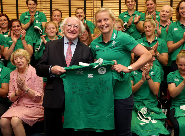 President of Ireland Michael D. Higgins gets presented a jersey by Ireland captain Claire Molloy