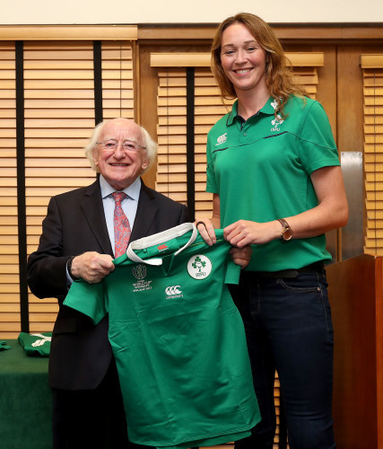 President of Ireland Michael D. Higgins presents a jersey to Marie-Louise Reilly