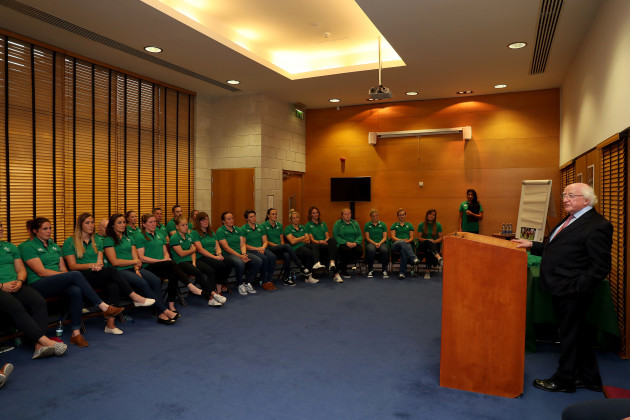 President of Ireland Michael D. Higgins talks to the players before presenting the jersey's