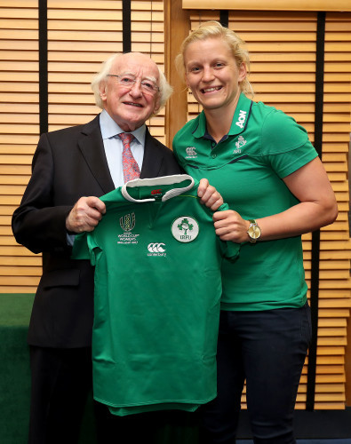 President of Ireland Michael D. Higgins presents a jersey to Claire Molloy
