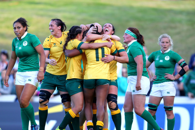 Mahalia Murphy celebrates scoring their first try with teammates